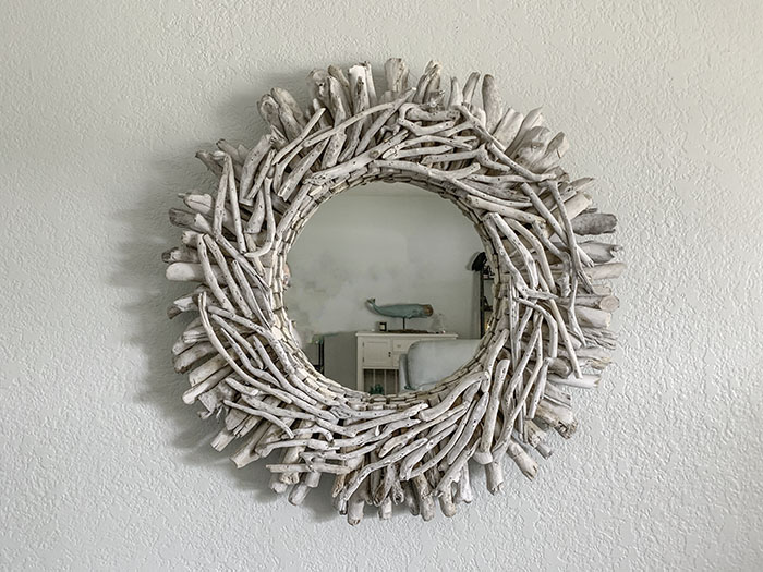 coastal decor with driftwood framed mirror