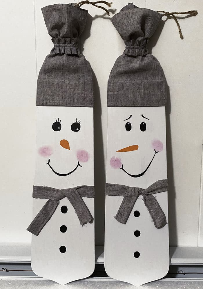 painted snowman on wood decoration
